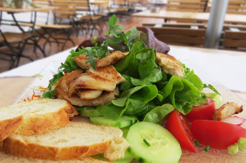 Salad with grilled chicken breast strips